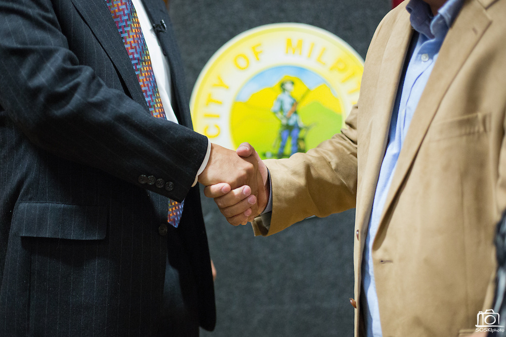 Milpitas Mayor Jose Esteves shakes hands and talks with guests during the Milpitas State of the City Address at the Milpitas Community Center in Milpitas, California, on May 30, 2013. (Stan Olszewski/SOSKIphoto)