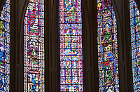 Our Lady of Chartres Cathedral, Chartres, France. Stained glass windows - light shining through the windows creates a beautiful, warm ambiance.