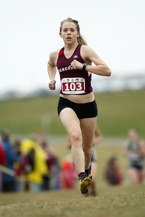 (Kingston, Ontario -- 14 Nov 2009)  KELLY HEWITT of the Concordia University runs to 122 place at the  2009 Canadian Interuniversity Sport CIS Cross Country Championships at Forth Henry Hill in Kingston Ontario. Photograph copyright Sean Burges / Mundo Sport Images, 2009.