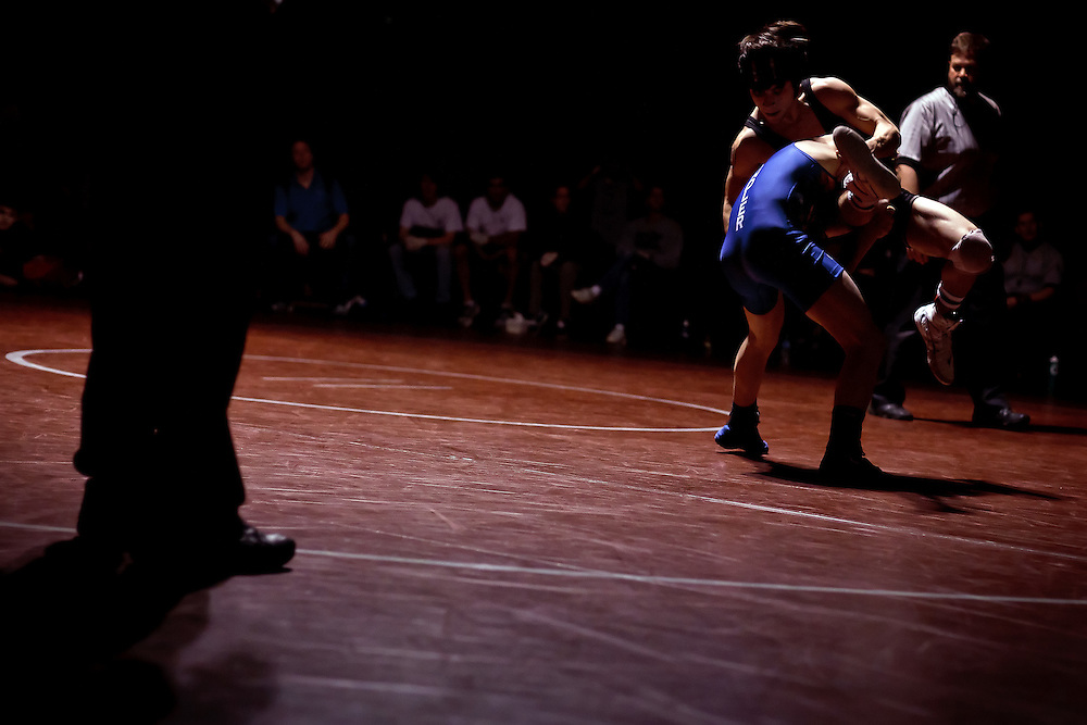 A Chandler High wrestlers lifts his opponent off the mat during the 120-pound championship match Saturday at the Tri-State tournament.