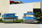 Display of Rental Surfboards Outside the  Infinity Surfboards Shop