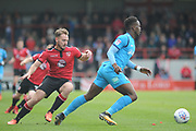 Barnet Defender, David Tutonda (13) and Morecambe Forward, Adam McGurk (28)  during the EFL Sky Bet League 2 match between Morecambe and Barnet at the Globe Arena, Morecambe, England on 28 April 2018. Picture by Mark Pollitt.