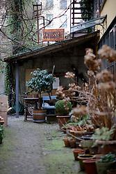 SWITZERLAND ZURICH 3MAR12 - Schlosserei sign in a backyard with potted plants in Zurich city centre, Switzerland. ....jre/Photo by Jiri Rezac....© Jiri Rezac 2012