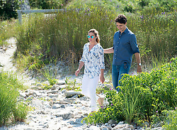 Prime Minister Justin Trudeau and his wife Sophie Gregoire Trudeau head to the beach at Kejimkujik Seaside National and Historic Park in Port Joli, N.S., Canada, on Friday, July 21, 2017. Photo by Andrew Vaughan/CP/ABACAPRESS.COM