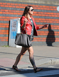 Melanie Chisholm aka Mel C wearing a red leather bikers jacket, star top, stripy skirt and zebra pattern sandals enjoying the sunshine in London. Mel C has replaced Helen Flanagan as the face of Specsavers' annual Spectacle Wearer of the Year competition. UK. 05/05/2013<br />BYLINE MUST READ : JAMESY/GOTCHA IMAGES<br /><br />Copyright by © Gotcha Images Ltd. All rights reserved.<br />Usage of this image is conditional upon the acceptance <br />of Gotcha Images Ltd, terms and conditions available at<br />www.gotchaimages.com