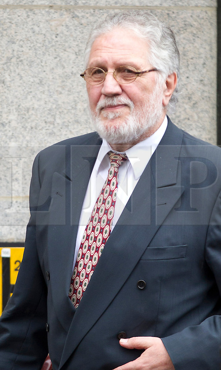 © Licensed to London News Pictures. 06/09/2013. London, UK. Former radio disc jokey Dave Lee Travis, real name David Patrick Griffin, leaves the Old Bailey with a police escort in London today (06/09/2013) ahead of his trial for sexual assault. Travis, who was arrested by the Metropolitan Police as part of the Operation Yewtree inquiry, is charged with with several counts of indecent or sexual assault dating back to the 1970's. Photo credit: Matt Cetti-Roberts/LNP