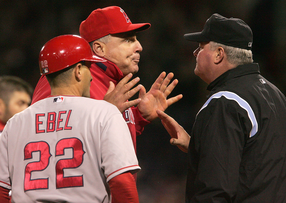 (Boston, MA - October 6, 2008) - Los Angeles Angels of Anaheim manager Mike Sciosia reacts to umpire Tim Welke's out call on a squeeze play in the ninth of ALDS Game 4 against the Boston Red Sox. Sciosia was upset because Sox catcher Jason Varitek dropped the ball after tagging Angels runner Reggie Willits as he tried to get back to third base. The Sox went on to beat the Angels 3-2 at Fenway Park to clinch a spot in their second straight ALCS. ..Photo by Will Nunnally / Boston Red Sox