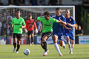 Forest Green Rovers Christian Doidge(9) shields the ball from Leeds United's Kaylin Phillips(23) during the Pre-Season Friendly match between Forest Green Rovers and Leeds United at the New Lawn, Forest Green, United Kingdom on 17 July 2018. Picture by Shane Healey.