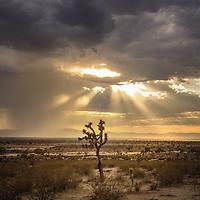Remote desert location in America with sunlight shinig through clouds