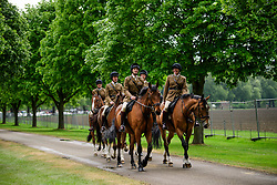 © Licensed to London News Pictures. 12/05/2017. Windsor, UK.  Military horses make this water through the grounds on day three of the Royal Windsor Horse show. The five day equestrian event takes place in the grounds of Windsor Castle. Photo credit: Ben Cawthra/LNP