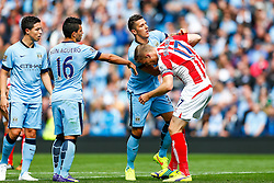Stevan Jovetic of Manchester City and Ryan Shawcross of Stoke tussle - Photo mandatory by-line: Rogan Thomson/JMP - 07966 386802 - 30/08/2014 - SPORT - FOOTBALL - Manchester, England - Etihad Stadium - Manchester City v Stoke City - Barclays Premier League.