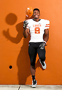 Lanier High School running back, Tario Fuller, stands in for a portrait on Tuesday at Lanier High School in Buford. Fuller, the team's top running back, recently committed to the Purdue University football program. (Staff Photo: David Welker)