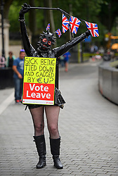 © Licensed to London News Pictures. 21/06/2016. London, UK. A woman dressed in a bondage outfit campaigns for 'Vote Leave' in Westminster, central London, ahead of a referendum on the UK's membership of the EU on June 23rd.. Photo credit: Ben Cawthra/LNP