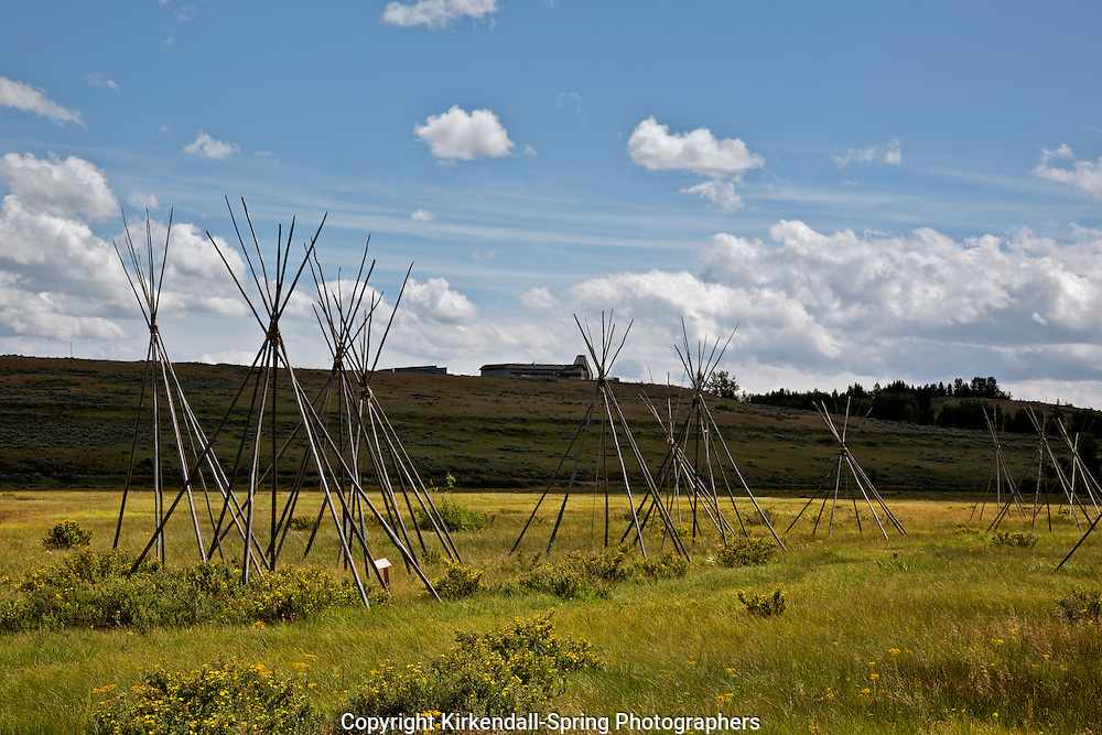 MT00081-00...MONTANA - Ghost teepees, poles standing to mark the location of where people were sleeping the night of the slaughter at the Big Hole National Battlefield. Visitor Center is on the hill overlooking the battlefield.