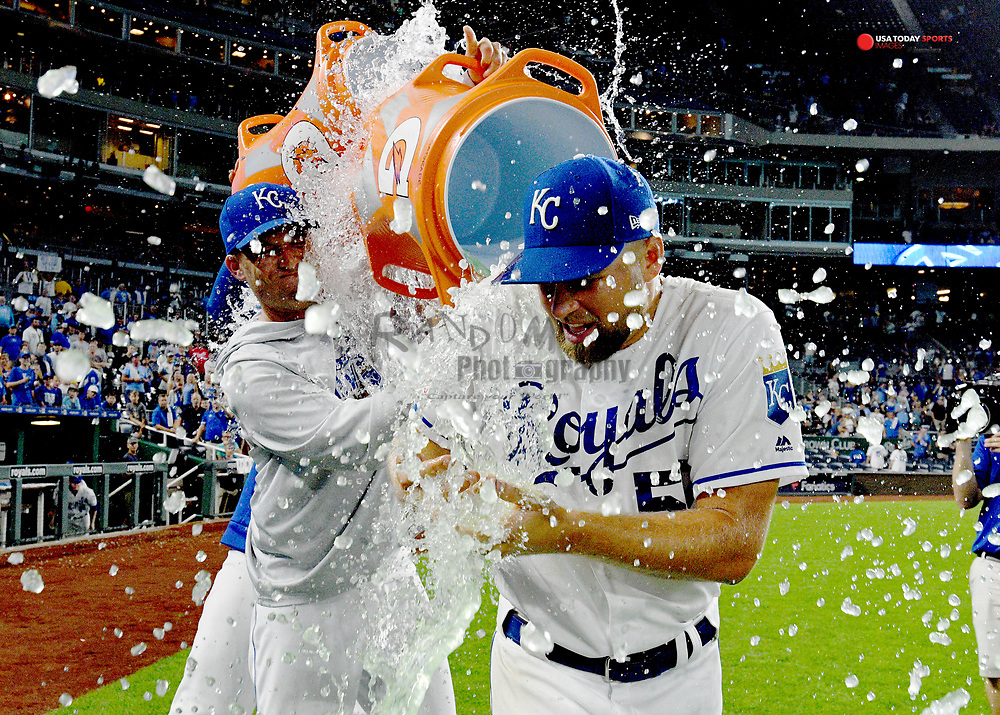 Jul 16, 2019; Kansas City, MO, USA; Kansas City Royals starting pitcher Glenn Sparkman (57) is doused by starting pitcher Danny Duffy (41) and starting pitcher Jakob Junis (65) after the win over the Chicago White Sox at Kauffman Stadium. Mandatory Credit: Denny Medley-USA TODAY Sports