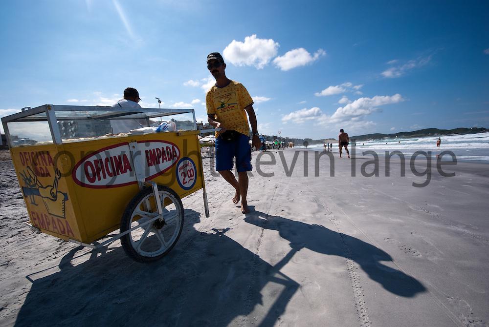 beach vendor at cabo frio beach in rio de janeiro, brazil.