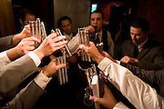 Groomsmen toast groom before wedding.