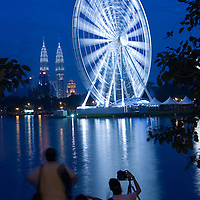 A 60-metre-high Ferris wheel stands beside Petronas Towers in Kuala Lumpur, Malaysia. Ferris wheel called 'Eye on Malaysia' similar to the 'London Eye' will be one of the main attractions for the Visit Malaysia year 2007.