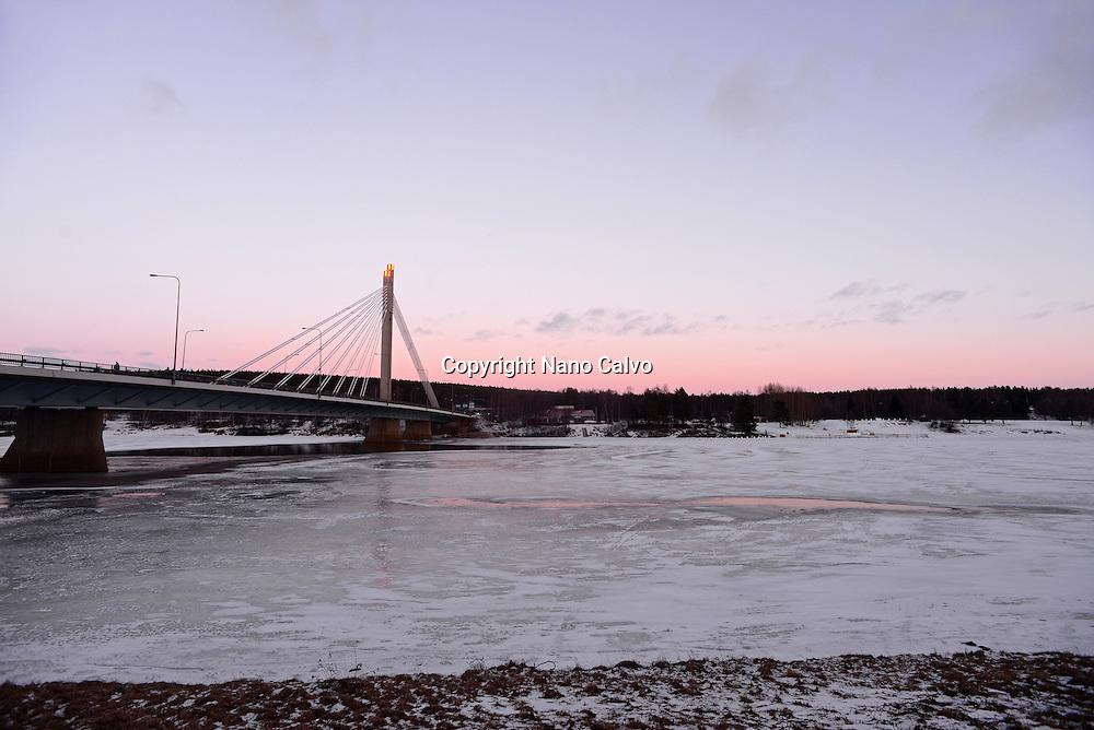 Frozen Kemijoki river at sunset, Rovaniemi.