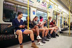 "© Licensed to London News Pictures. 13/01/2019. London, UK. Participants take part in 10th anniversary of 'No Trousers Tube Ride' event by travelling on the District Line on the London underground to surprise fellow passengers. The ""No Pants Subway Ride"" is an annual event staged by Improve Everywhere every January in New York City. The mission started as a small prank with seven guys and has grown into an international celebration of silliness, with dozens of cities including London around the world participating each year. Photo credit: Dinendra Haria/LNP"