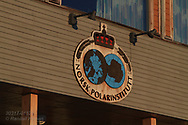 Norwegian Polar Institute emblem adorns the largest research station at the international science village of Ny-Alesund on Spitsbergen island in Kongsfjorden; Svalbard, Norway.