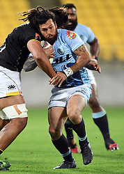 Northland's Rene Ranger fends off Wellington opponent in the Mitre 10 Rugby match at Westpac Stadium, Wellington, New Zealand, Thursday, October 12 2017. Credit:SNPA / Ross Setford  **NO ARCHIVING**