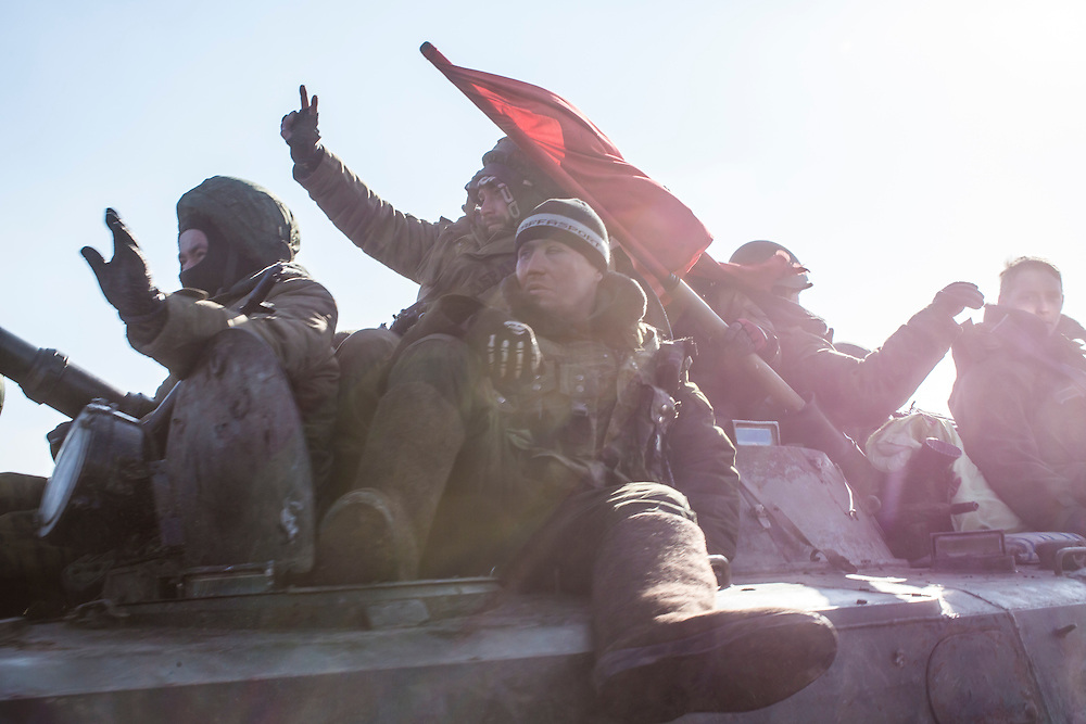 ZORYNSK, UKRAINE - FEBRUARY 20: Pro-Russian rebels drive away from the town of Debaltseve on February 20, 2015 in Zorynsk, Ukraine. Ukrainian forces withdrew from the strategic and hard-fought town after being effectively surrounded by pro-Russian rebels, though fighting has caused widespread destruction. (Photo by Brendan Hoffman/Getty Images) *** Local Caption ***