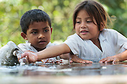 Children play with water from a fountain at the primary school in the town of Coyolito, Honduras on Wednesday April 24, 2013.