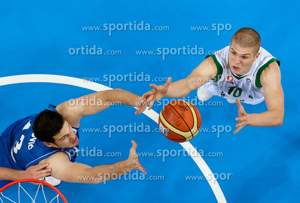 Kosta Perovic of Serbia vs Edo Muric of Slovenia during basketball game between National basketball teams of Slovenia and Serbia in 7th place game of FIBA Europe Eurobasket Lithuania 2011, on September 17, 2011, in Arena Zalgirio, Kaunas, Lithuania. Slovenia defeated Serbia 72 - 68 and placed 7th. (Photo by Vid Ponikvar / Sportida)