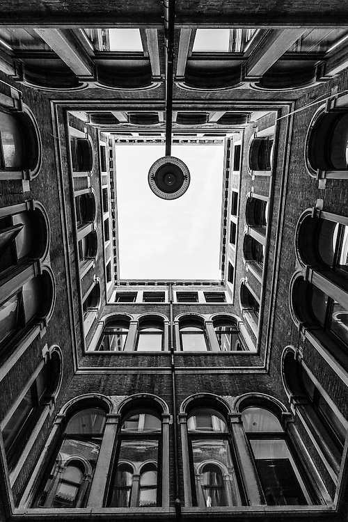 Where: Venice, Italy.<br /> I say again, this is why we need to look up. Great lines coming together with the lamp almost looking at us in then middle. Then the reflections in the windows are excellent too.
