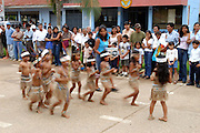 Peru - Saturday, Dec 07 2002: Children dressed as indigenous Indians take part in a parade in Puerto Maldonado. (Photo by Peter Horrell / http://www.peterhorrell.com)