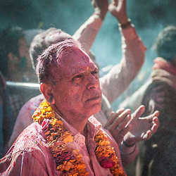 Coloured man during celebrations of Holi festival, Vrindavan, India