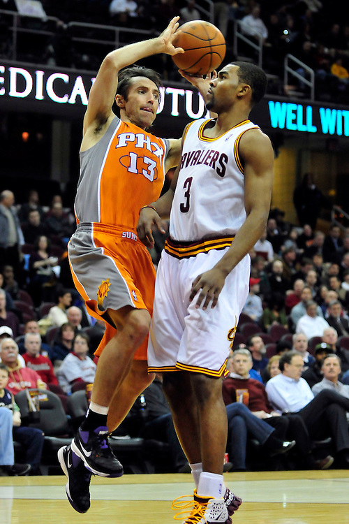 Jan. 19, 2011; Cleveland, OH, USA; Phoenix Suns point guard Steve Nash (13) looks for a pass over Cleveland Cavaliers point guard Ramon Sessions (3) during the first quarter at Quicken Loans Arena. Mandatory Credit: Jason Miller-US PRESSWIRE