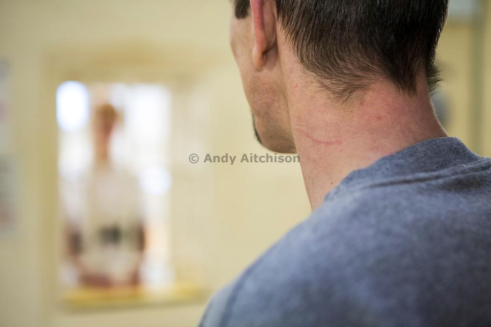 A prisoner visiting the prisoner nurse to get his daily medication. HMP/YOI Portland, Dorset. A resettlement prison with a capacity for 530 prisoners. Portland, Dorset, United Kingdom.
