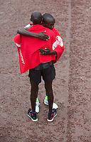 Eliud Kipchoge  of Kenya embraces last years winner Wilson Kipsang after winning the Elite Mens race at the Virgin Money London Marathon , Sunday 26th April 2015.<br /> <br /> Dillon Bryden for Virgin Money London Marathon<br /> <br /> For more information please contact Penny Dain at pennyd@london-marathon.co.uk