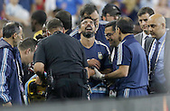 HOUSTON, TEXAS - JUNE 21:  Ezequiel Lavezzi #22 of Argentina reacts to an injury after he flipped over the boards while heading the ball during play in the second half before the Semifinal match between Argentina and US at NRG Stadium as part of Copa America Centenario US 2016 on June 21, 2016 in Houston, Texas, US. (Photo by Thomas B. Shea/LatinContent/Getty Images)