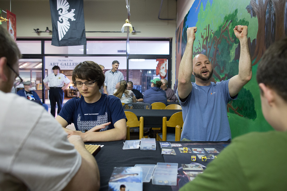 Evan Knowles, left, plays &quot;Go&quot; against Nate Yentzer while Bryan Wakefield, right, plays a Star Wars card game against Kade Wakefield at Great Escape Adventures, a game store at Arnot Mall in Elmira, New York on Thursday, May 25, 2017. CREDIT: Mike Bradley for the Wall Street Journal<br /> RIPPLES