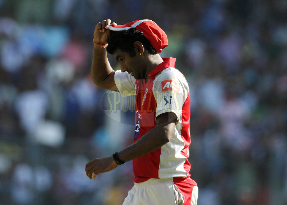 Kings XI Punjab player Parvinder Awana reacts after he drops a catch during match 28 of the Indian Premier League ( IPL) 2012  between The Mumbai Indians and the Kings X1 Punjab held at the Wankhede Stadium in Mumbai on the 22nd April 2012..Photo by: Vipin Pawar/IPL/SPORTZPICS