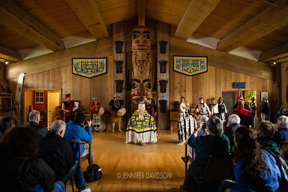 Guests from the National Geographic Sea Lion watch a traditional Haida dance performance in artist Christian White's long house in Old Masset, Haida Gwaii.