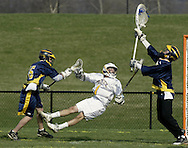 Pine Bush goalie Joey Schof, right, reaches for the ball as teammate Casey Gross knocks down Warwick's James Kolesar during a game in Warwick on Friday, April 15, 2011.