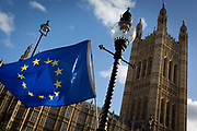 The stars of the EU flag fly over the Victoria Tower at the  Houses of Parliament in Westminster, seat of government and power of the United Kingdom during Brexit negotiations with Brussels, on 23rd November 2017, in London England.