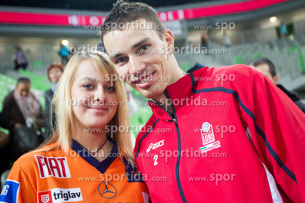 Alen Pajenk of Macerata with a fan after the volleyball match between ACH Volley and Lube Banca Marche Macerata (ITA) in 5th Leg of Pool D of 2013 CEV Champions League on December 5, 2012 in Arena Stozice, Ljubljana, Slovenia. ACH defeated Macerata 3-1. (Photo By Vid Ponikvar / Sportida)