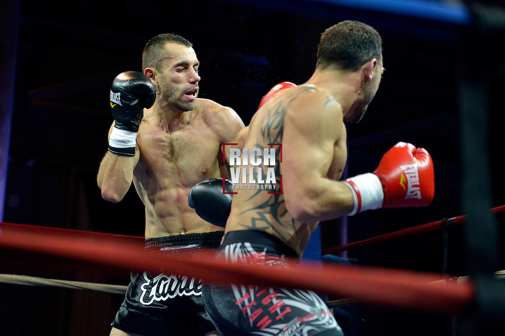 Nick Pace(lRight) connects with a left hook onto Niko Tsigaras(Left) face. Combat at the Capitale at the Capitale Theater in New York City on September 27, 2013