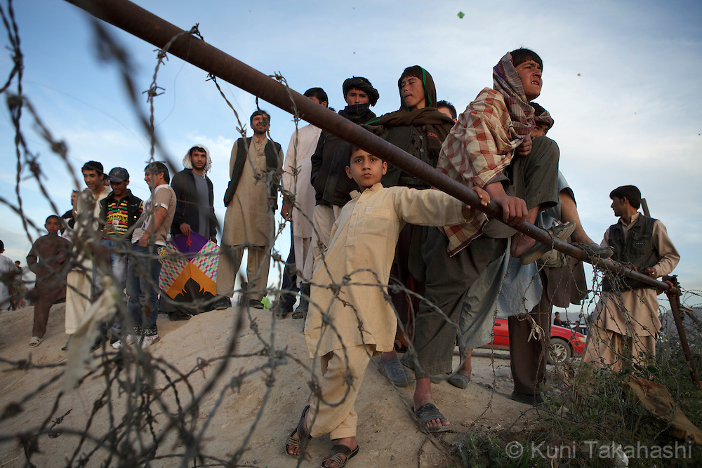 (Kabul Afghanistan - May 4, 2012).Young people gather on top of the hill in Kabul, Afghanistan on May 4, 2012. After years of war, severe poverty and poor security, Afghanistan is considered to be among the most dangerous places for children..(Photo by Kuni Takahashi)