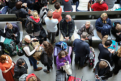 © Licensed to London News Pictures. 30/03/2019. London, UK. Thousands of travellers at London St Pancras as Eurostar suspends all trains to and from London. The travellers face severe delays and cancellations after a man spent the night on the roof of London's St Pancras Station. British Transport Police arrested a 44-year-old man this morning after he made his way onto the overhead viaduct of the station. Photo credit: Dinendra Haria/LNP