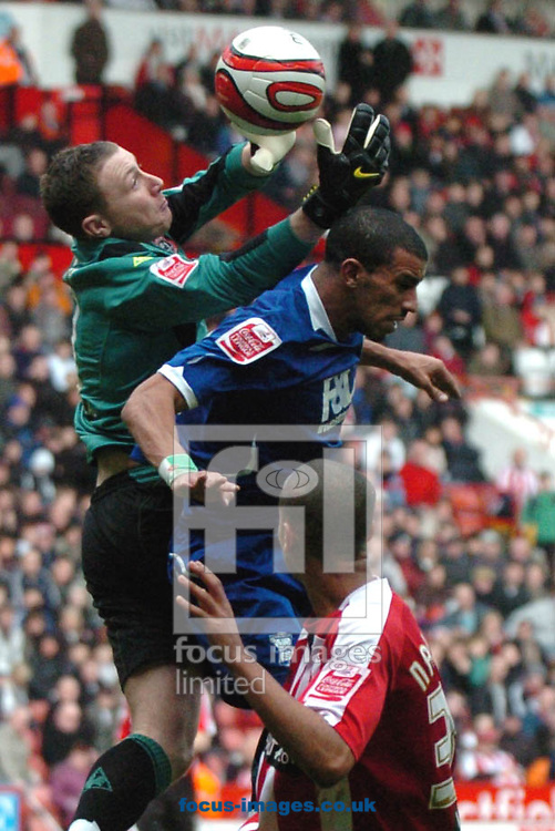 Sheffield - Sunday, March 1st, 2009:  Sheffield United's Kyle Naughton watches his keeper, Paddy Kenny beat Birmingham City's  Hameur Bouazza to the ball during the Coca Cola Championship match at Bramall Lane, Sheffield. (Pic by John Rushworth/Focus Images)