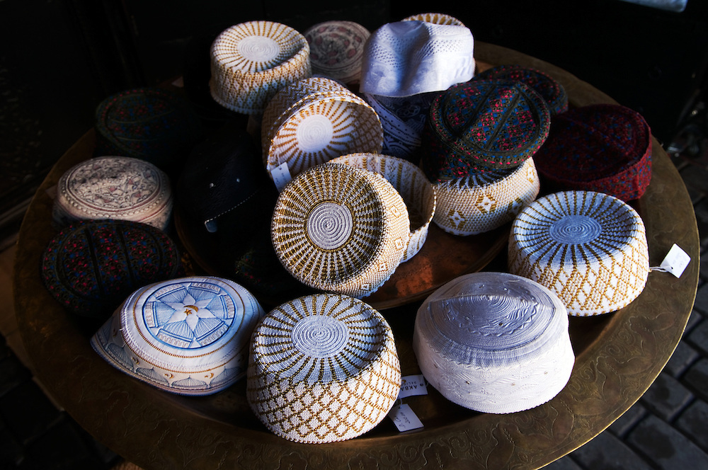 MOROCCO: Marrakesh.Moslem caps for sale in the bazar, made of wool, cotton and silk.