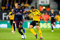 Jonny of Wolverhampton Wanderers goes past Ainsley Maitland-Niles of Arsenal - Mandatory by-line: Robbie Stephenson/JMP - 24/04/2019 - FOOTBALL - Molineux - Wolverhampton, England - Wolverhampton Wanderers v Arsenal - Premier League