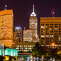 Indianapolis skyline at night picture with downtown Indianapolis city office buildings.