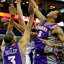 December 30, 2011; New Orleans, LA, USA; New Orleans Hornets shooting guard Marco Belinelli (8) shoots as Phoenix Suns small forward Jared Dudley (3) and center Channing Frye (8) defend during the first quarter of a game at the New Orleans Arena.   Mandatory Credit: Derick E. Hingle-US PRESSWIRE